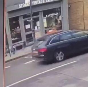 Shocking CCTV: Pedestrian narrowly avoids being crushed by collapsing roof in east London