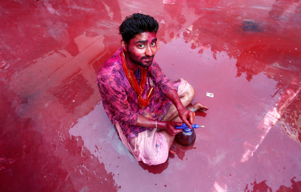A Hindu devotee takes part in the religious festival of Holi inside a temple in Nandgaon village, in the state of Uttar Pradesh, India February 25, 2018.